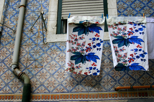 While walking through the winding streets of Alfama to Graca and Santa Clara, this pattern-on-pattern scene caught my eye.  I couldn't stop looking up the entire time we were in Lisbon.  These stunning azulejos (hand painted, tin-glazed ceramic tiles) adorn virtually every building, from churches and train stations to ordinary homes... and the hanging laundry only adds to the charm. (img: Sean Patrick Doyle)